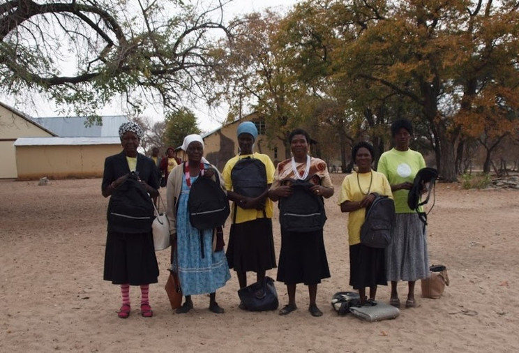 Ombome Oto volunteers with their new bags