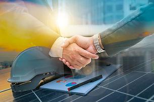 Businessmen are shaking hands for busine