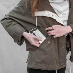 woman-face-mask-jacket-pocket.jpg