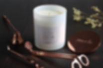 Rose gold accessory and naturally scented candle