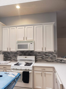 Painted cabinets, backsplash