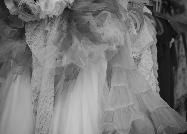 Black and white image of tulle skirts on a rack