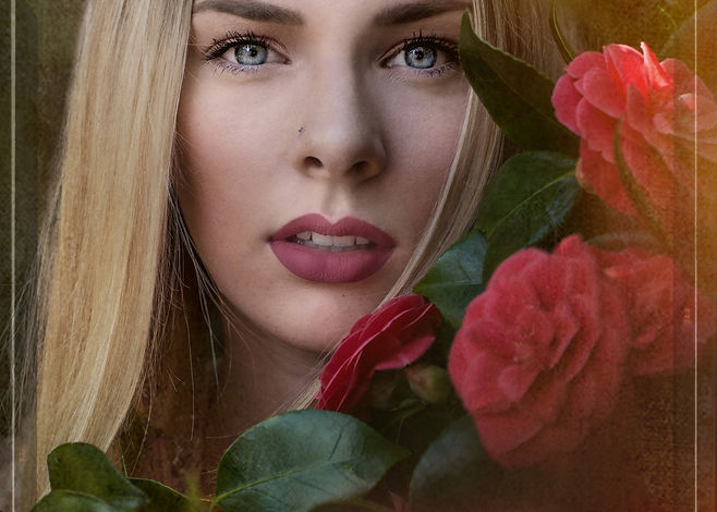 Blonde woman in red camelias