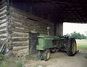 Old green tractor in a shed