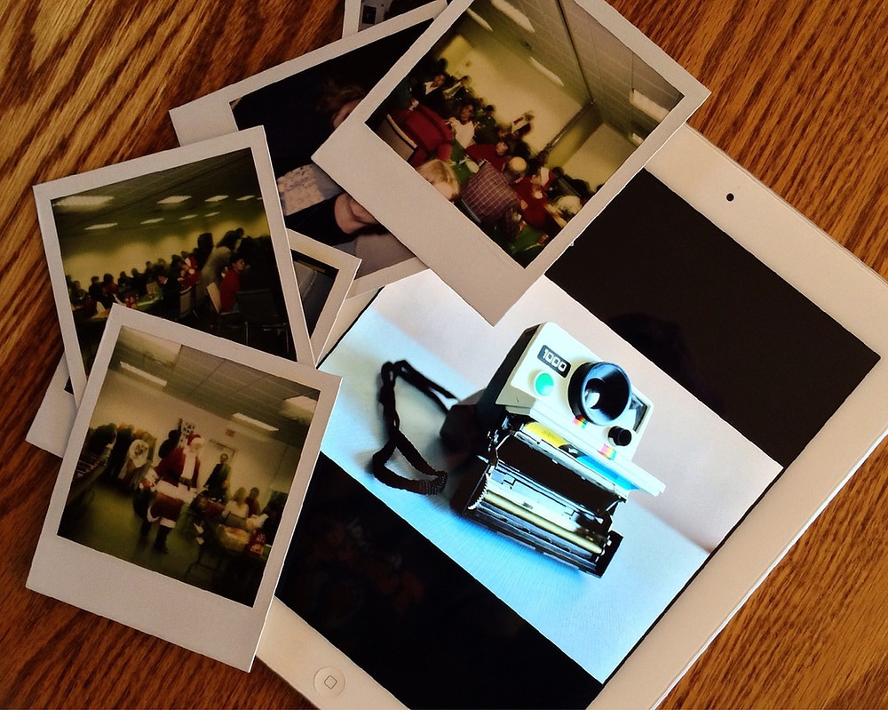 Vintage Polaroid instant camera and prints