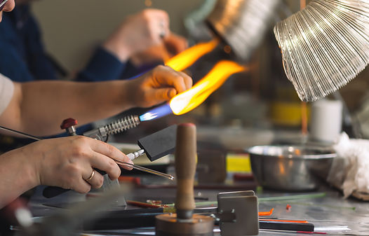 Students at work in a glass-blowing work