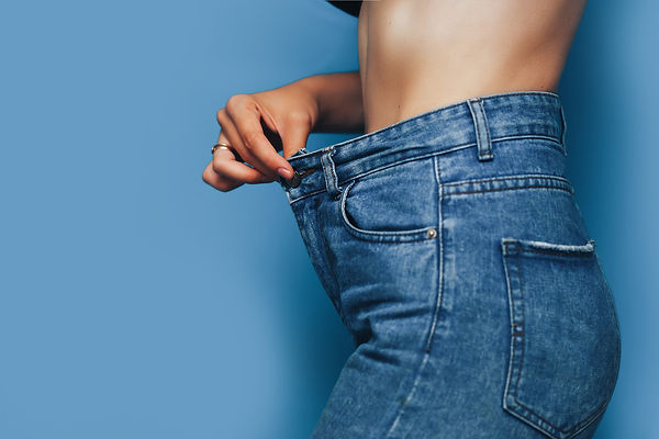 skinny woman body with Loose pants jeans
