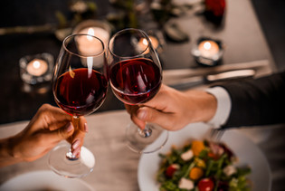 Couple Drinking Wine at Dinner