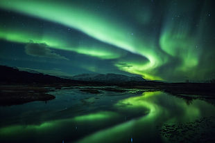 northern-lights-above-a-lagoon-in-icelan