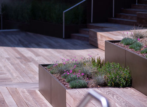 Every Green Theory product is artistically designed and thoughtfully manufactured. Metal and Composite Planters for indoor and outdoor environments are the flagship lines of this creative and very green-conscious company. But look a bit closer and you be rewarded with an increasing line of decorative Architectural and Site products pertinent to today. In addition to their unique running line offering, Green Theory is most know for custom, large-scale metal planters for just about any commercial environment. Please visit their site to learn more about this wonderful company!