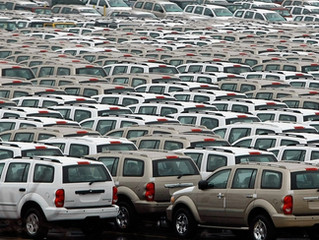 Dealer's first overflow lot in 37 years sign of U.S. inventory pileup