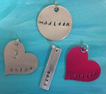 hand-stamped-4-charms-300x266.jpg
