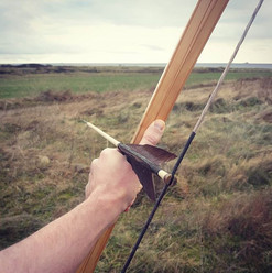 The Sami two wood bows have a uniqe cros