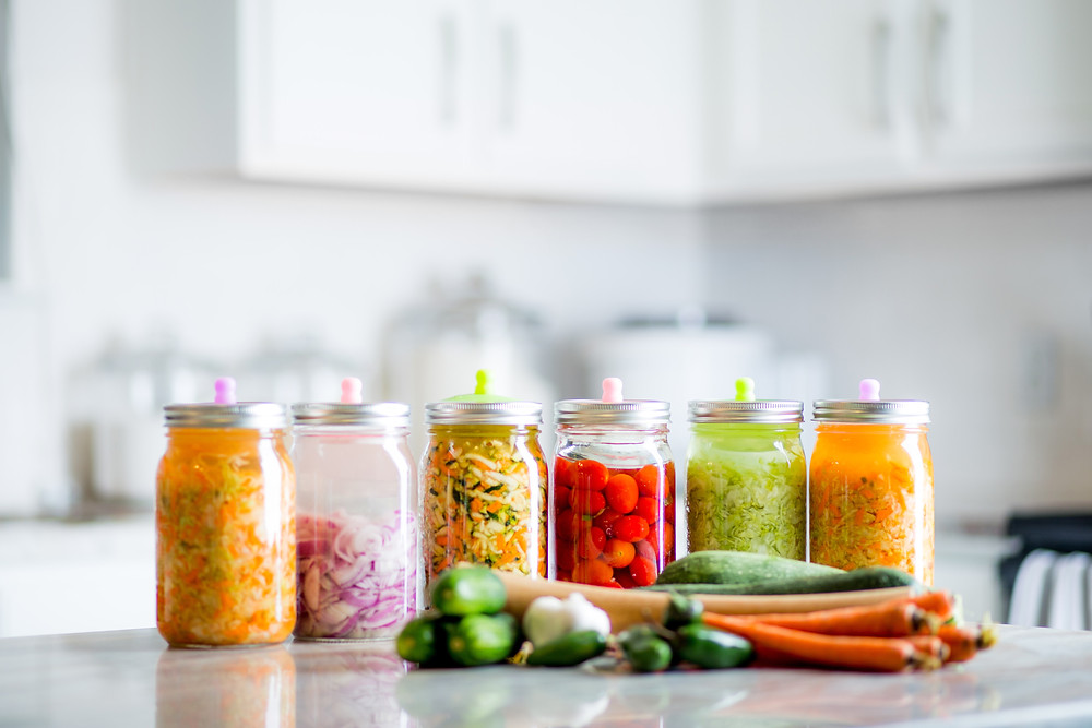 Jars of fermented foods that are good for your gut