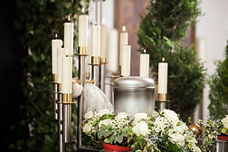 urn with candles and flowers