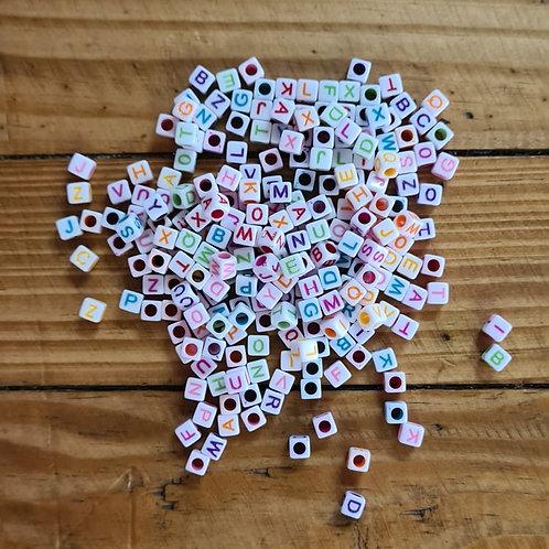 Mini letras collor cubo pequeno 100 gramas