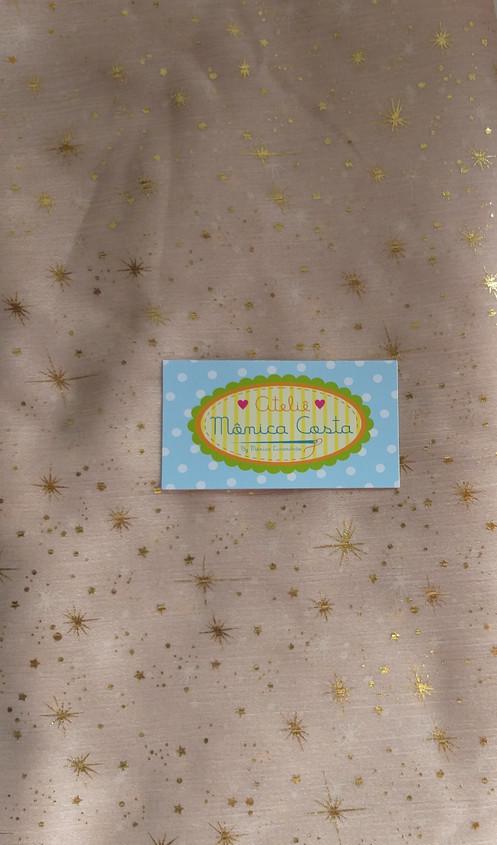 2a8d61feb4 Tule estrelas douradas