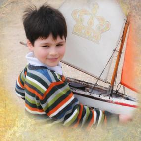 boywithboatmergepaper.jpg