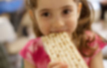 Cute-Smiling-Girl-Eating-Matzah.jpg