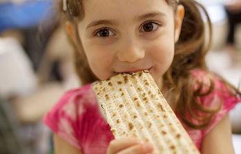 Cute-Smiling-Girl-Eating-Matzah.jpg