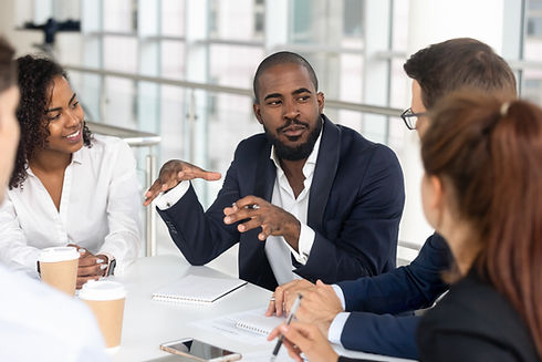 Millennial employees gathered in boardroom for training, black boss ceo leader leading cor