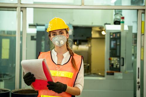 Female Mechanic wearing  protective mask