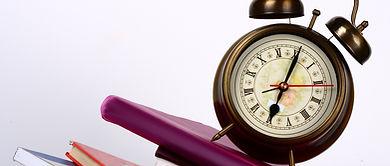 alarm_clock_on_book-1920x1200.jpg