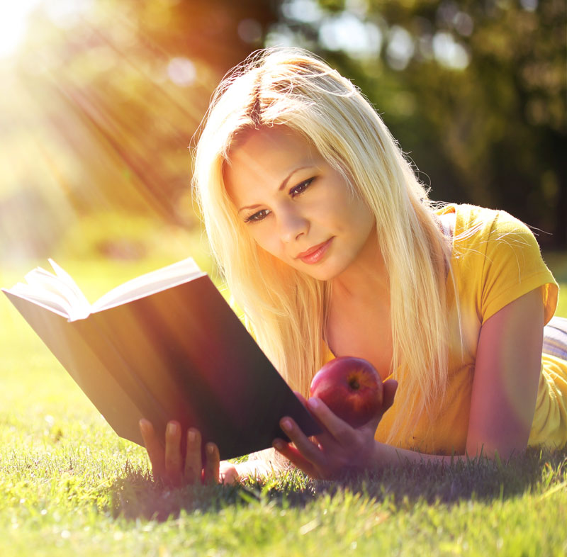 Girl reading book | sun flare effect