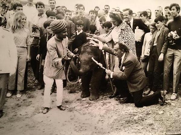 SALVADOR DALI PRESENTED AN ELEPHANT BY A
