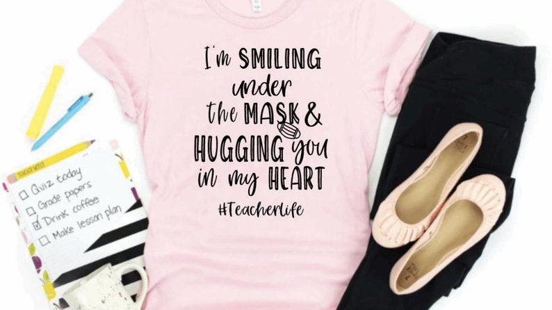 I'm smiling under my mask & hugging you in my heart t-shirt- Teacher Life