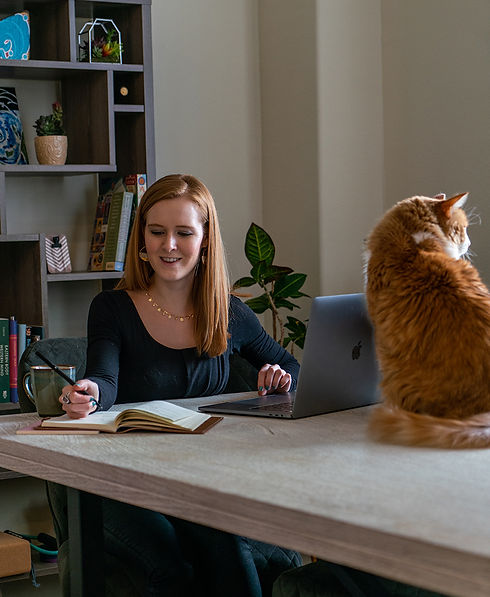 Nikki Nandrasy working on Retainer Program Clients with cat