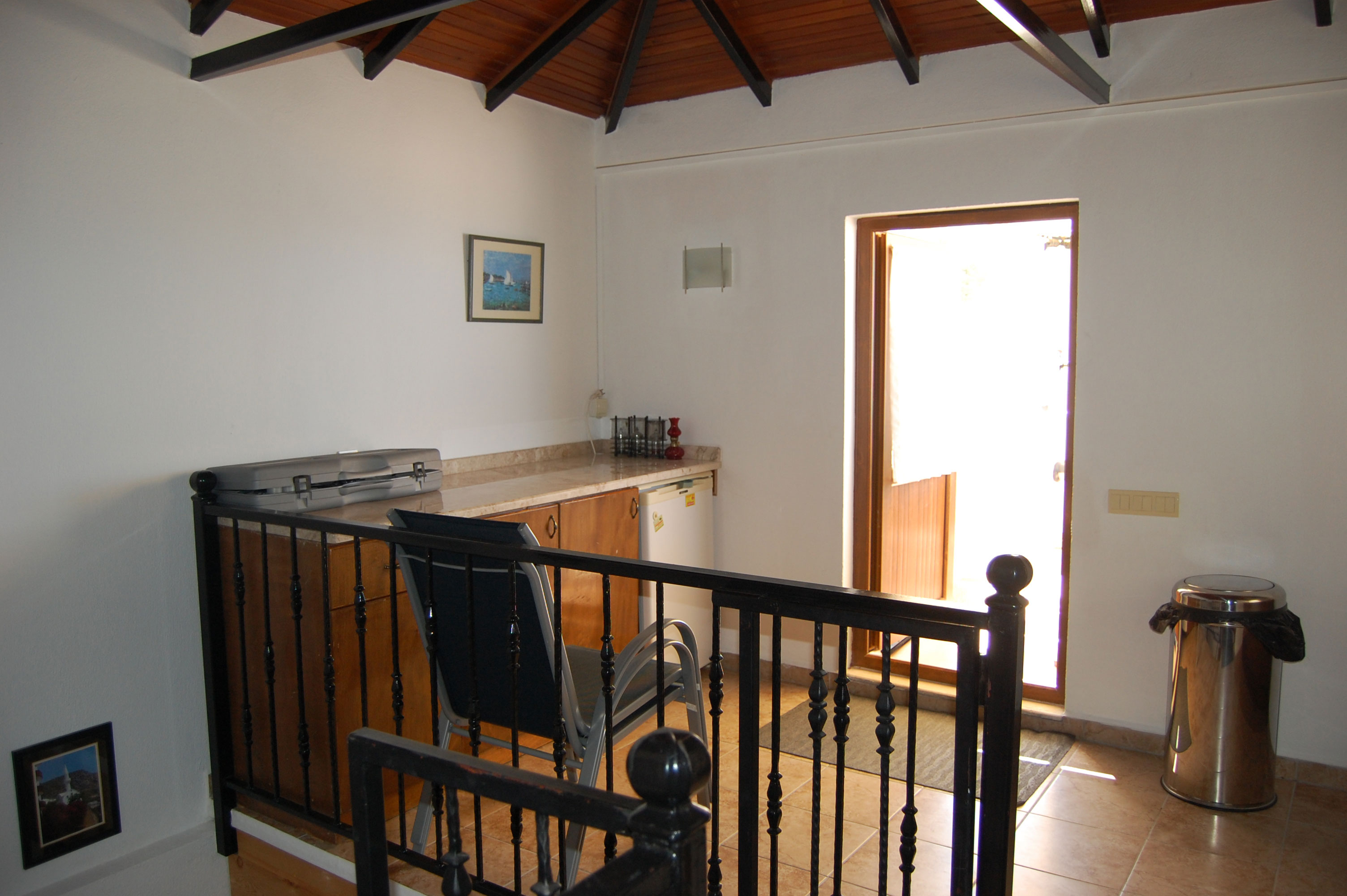 Upstairs kitchen out to roof terrace