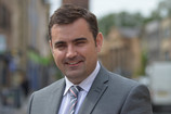 LOCAL MP CALLS FOR END TO UNFAIR WITHDRAWAL CHARGES