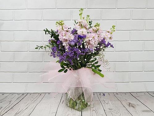 Hand-tied bouquet in aqua-pack