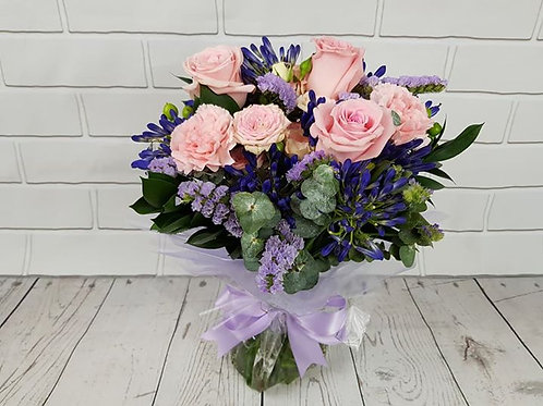 Hand-tied bouquet in aqua-pack