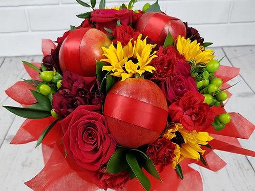 Red apples in stunning flower bouquet