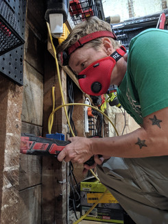 Cutting a small rectangle in 100+-year-old timbers for an outlet.