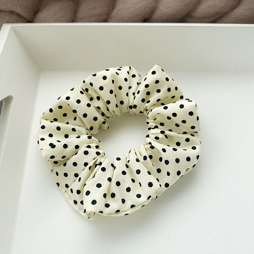 Black dots on cream
