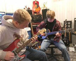 Tricia & Johnny Lightfoot Guitar and Bass Lessons with Johnny Lightfoot Lightfoot Productions Jason