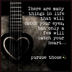 quote pic of guitar with heart hole pursue that