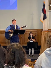 Ron worship with Emily Taber.jpg