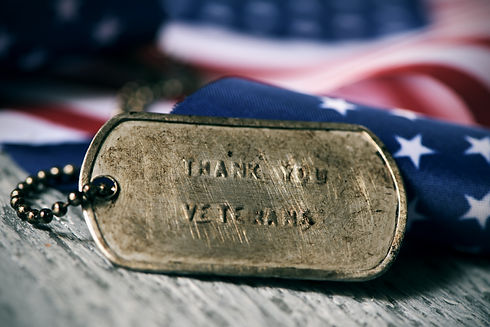 closeup of a rusty dog tag with the text