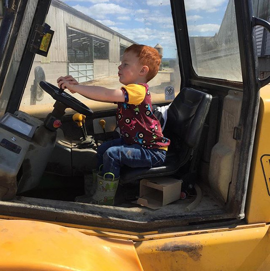 Jack in his tractor t-shirt and driving