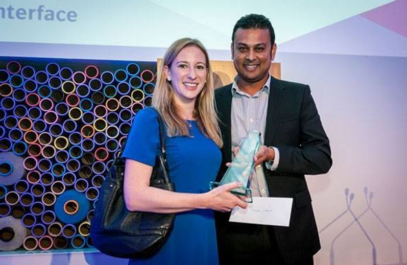 A photograph of Within's director winning an award from Interface Flor for the carpet design of Karratha Senior High School