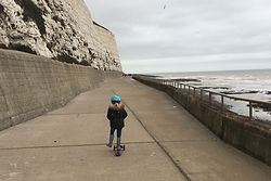 Scooting-along-Undercliff-Walk-compresso