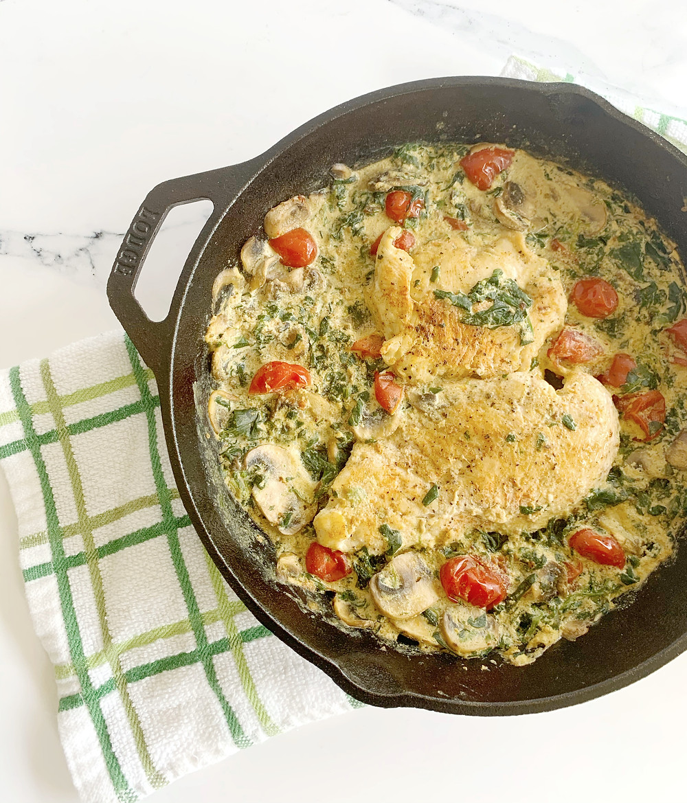 dairy free tuscan chicken in cast iron skillet