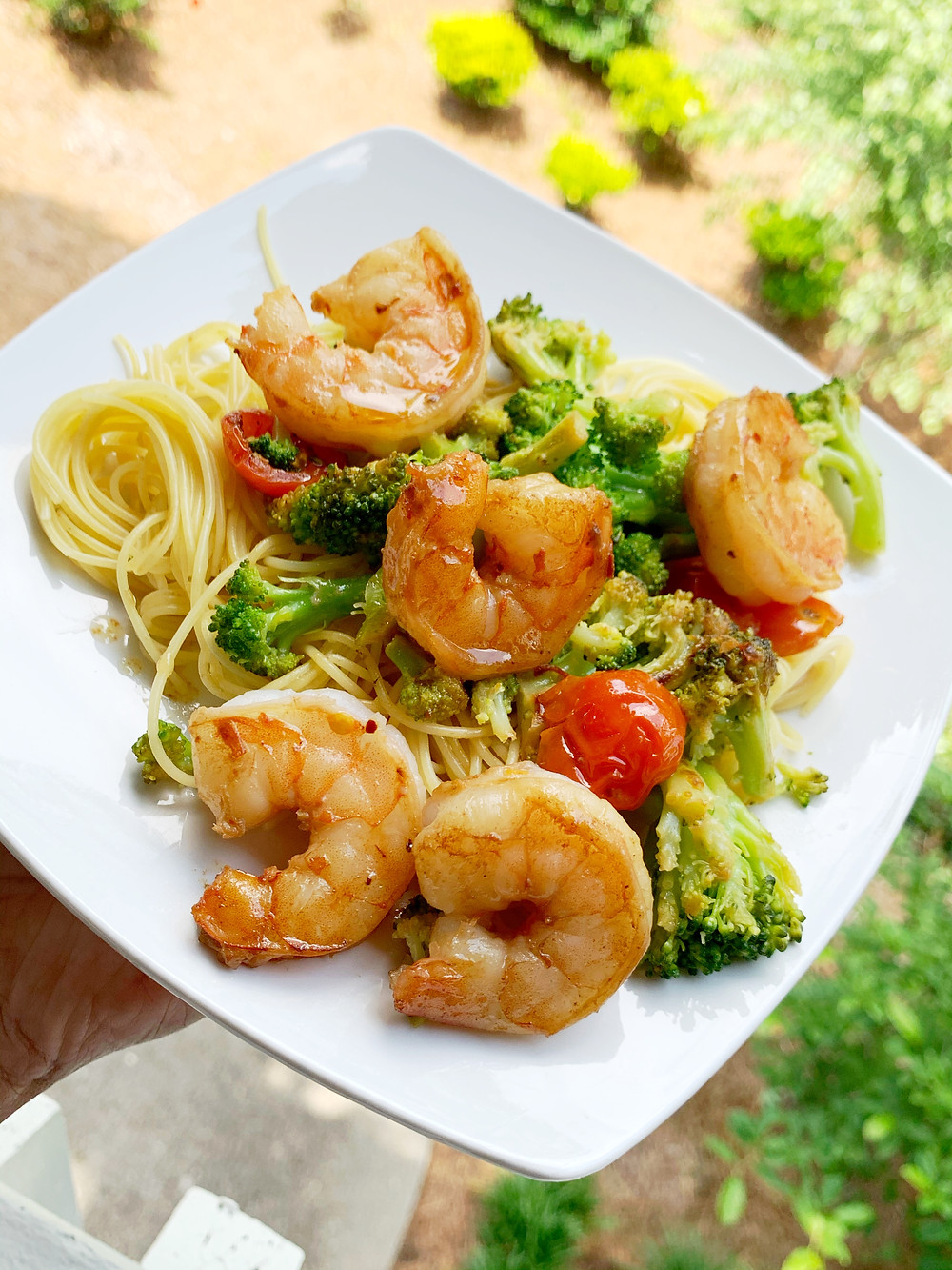 garlic shrimp scampi with angel hair pasta, broccoli, cherry tomatoes, and garlic butter sauce