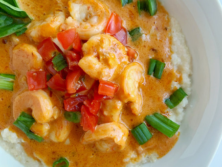 Cajun Shrimp and Grits with a Creamy Tomato Sauce