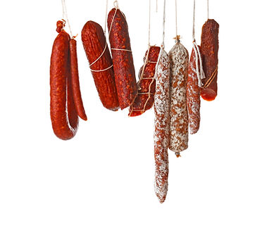 Delicious sausages hanging on white back