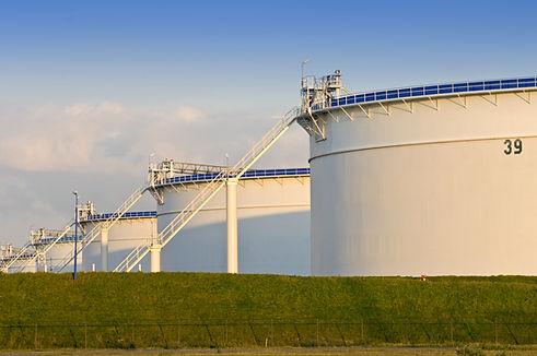 Oil storage tanks in the evening light.j